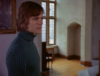 "Keir Dullea, all turtlenecks and shaggy 1970's hair, as Peter in ""Black Christmas"" (1974)."